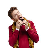 Man eats small cake Royalty Free Stock Image