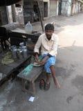 Man eats on the street Stock Image