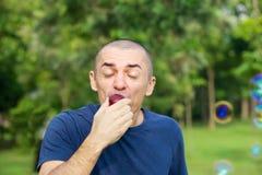 Man eats tasty plum Royalty Free Stock Photography