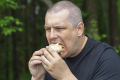 Man eats tortillas with chicken Stock Photo