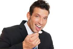 Man eats yogurt stock photos