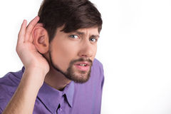 Man eavesdropping. Stock Photography