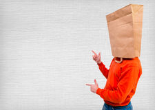 Man in ecological paper bag on head Royalty Free Stock Photography
