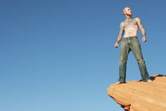 Man on edge Stock Photo