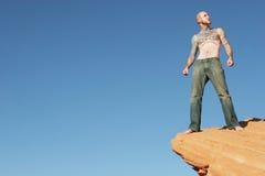 Man on edge Stock Photo