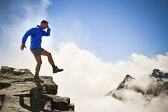 Man on the edge of the abyss. Man falling into the abyss. Italian Alps stock photos