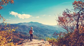 Man at the edge of a cliff Stock Images