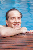 Man in the edge of the pool Royalty Free Stock Images