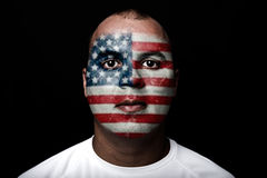 Man with EEUU flag. Painted on her face on black background Stock Image
