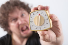 Man with Egg timer Stock Photography