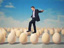 Man on eggs Stock Image