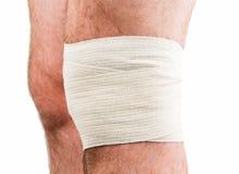 Man with elastic bandage on knee Stock Photo