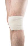Man with elastic bandage on knee Royalty Free Stock Images