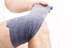 Man elastic bandage on knee stock photos