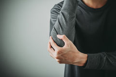 Man elbow pain. Man have elbow joint pain Royalty Free Stock Image