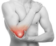 Man Elbow Pain - Studio shot isolated on white Stock Photo