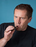Man with electric cigarette Royalty Free Stock Photography