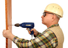 Man with an electric drill. Stock Images