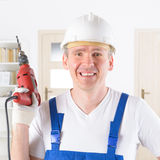 Man with electric drill Royalty Free Stock Photos