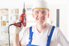 Man with electric drill Royalty Free Stock Image