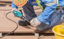 Man with electric drill at the work on backgrond. Royalty Free Stock Photo