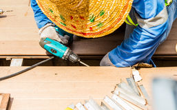 Man with electric drill at the work on backgrond. Royalty Free Stock Photos