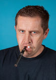 Man with electric and ordinary cigarette Royalty Free Stock Image