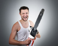 Man with electric saw Royalty Free Stock Photos