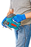 Man with electrical saw. In hands, over white background Royalty Free Stock Image