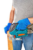 Man with electrical saw. In hands, over white background royalty free stock photography