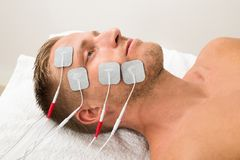 Man with electrodes on face Stock Photos