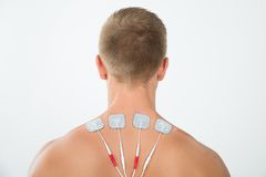 Man with electrodes on neck Stock Image
