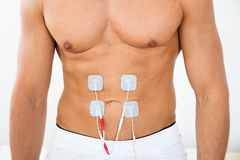 Man with electrodes on stomach Royalty Free Stock Photo