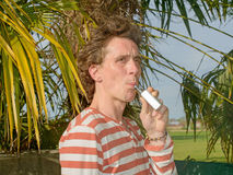 Man with an electronic cigarette Royalty Free Stock Images