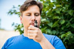 Man with electronic mode. E-cig stock photography