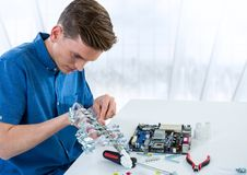Man with electronics against blurry window Stock Photos