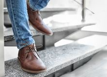 Man in in elegant shoes walking down stairs. Indoors Royalty Free Stock Photos