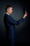 Man in an elegant suit and shoes in hand royalty free stock photography