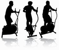 Man on elliptical orbitrek Stock Image