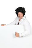 Man in an Elvis outfit Stock Photography