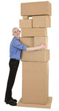 Man embrace heap cardboard boxes Stock Photos