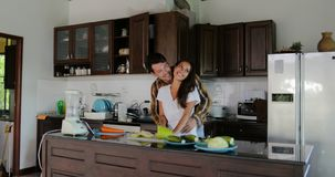 Man Embrace Woman Cutting Vegetables To Prepare Healthy Dinner Talking Couple In Kitchen Cooking Together. Slow Motion 60 stock footage