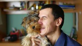 Man embraces and kisses a dog pet friendship indoor. Man embraces and kisses dog pet friendship indoor stock photos