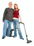 Man embraces woman with vacuum cleaner Royalty Free Stock Photos