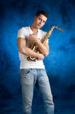 Man embracing her  sax Royalty Free Stock Photography