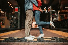 Male hugging pretty lady during rest outdoor stock images