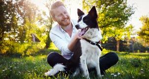 Man embracing his dog royalty free stock image