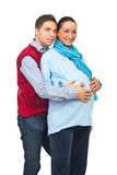 Man embracing his pregnant wife Stock Photo