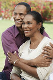 Man Embracing His Wife Stock Photography