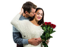 Man embracing and kissing girlfriend Royalty Free Stock Photography